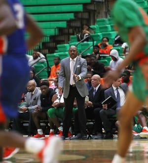 FAMU men's basketball coach Robert McCullum observes the action versus Savannah State.