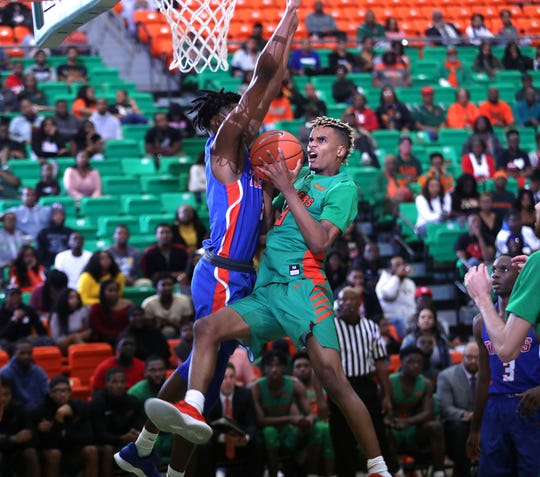 FAMU's M.J. Randolph goes hard in the paint versus Savannah State.