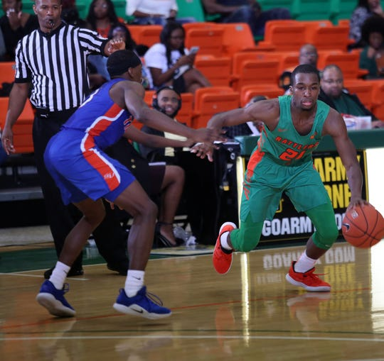 FAMU's Justin Ravenel drives by a defender. The Rattlers beat Savannah State 69-64 on Saturday, Jan. 12 in the Lawson Center.
