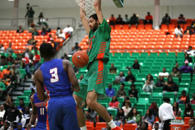 FAMU center Isaiah Martin jams home 2 of his 15 points against Savannah State.