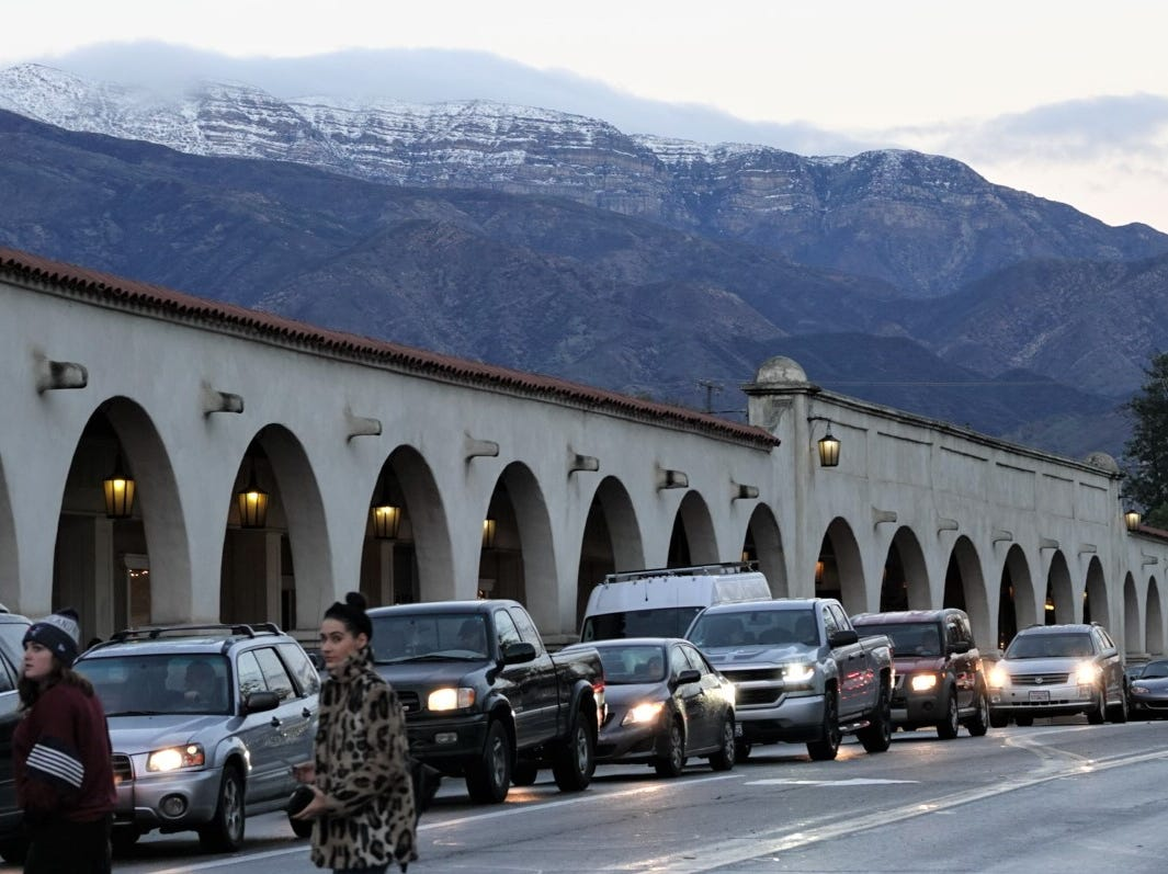 A winter storm left snow on local mountains Saturday, as seen from downtown Ojai.
