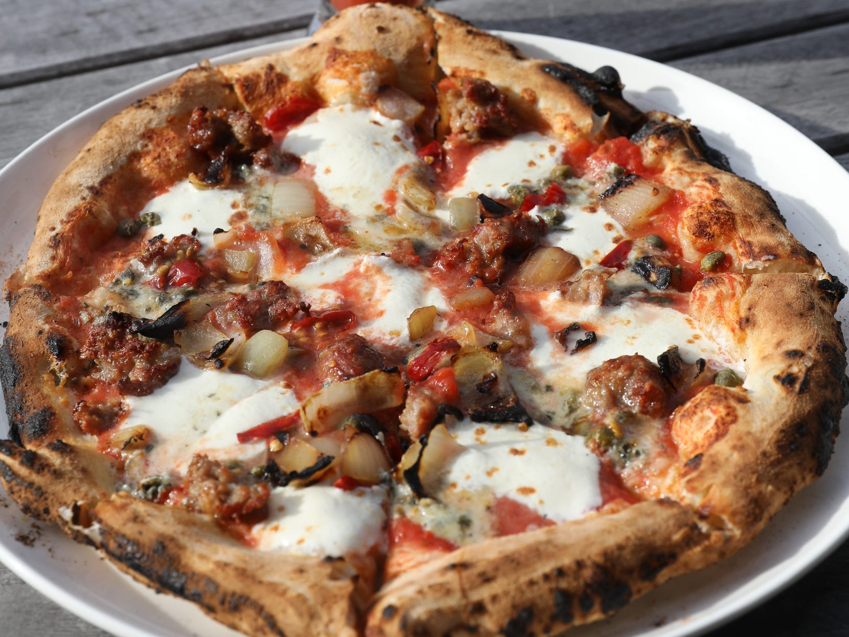 One of Chase Fox Harnett's pizzas:  a sausage gorganzola pizza.