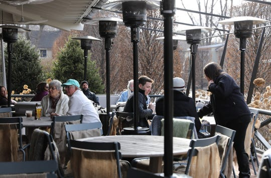 Guests enjoy lunch on the porch at the bar and grill at the Valley Rock Inn & Mountain Club in Sloatsburg on Saturday, January 12, 2019.