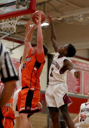 Thomas Plunkett of Mamaroneck goes to the basket while being defended by Aaron Joseph of Albertus Magnus during Two Counties, One Cause basketball tournament at Tappan Zee High School Jan. 12, 2019. Magnus defeated Mamaroneck 55-52.
