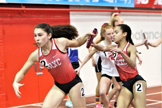 North Rockland's Haleigh Morales takes baton from Leyla Ventura during 4x800 2019 Stanner Games win.