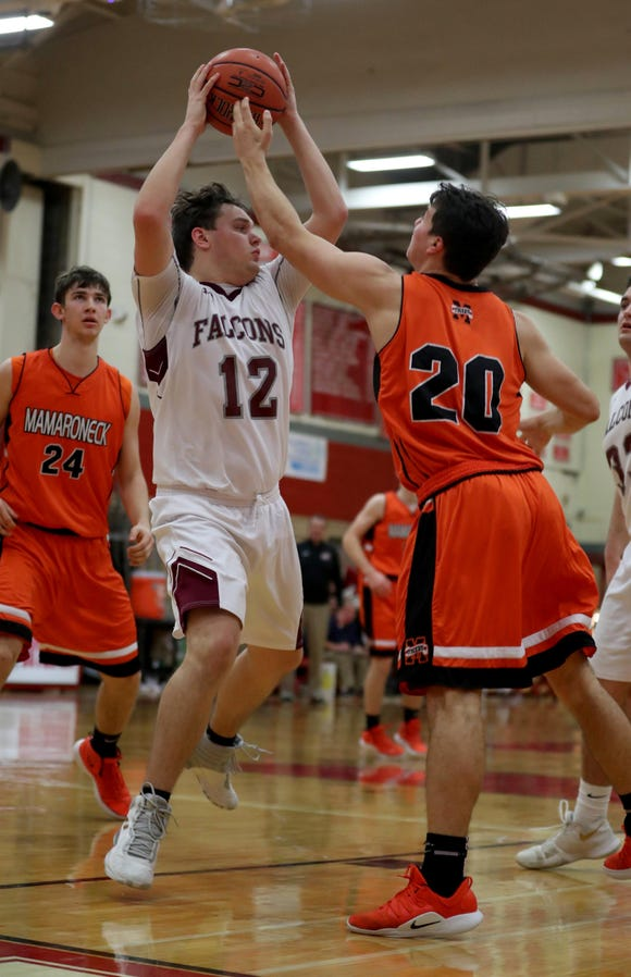 Colin Harrington of Albertus Magnus and Shane Smith of Mamaroneck battle during the Two Counties, One Cause basketball tournament at Tappan Zee High School Jan. 12, 2019. Magnus defeated Mamaroneck 55-52.