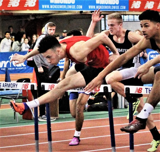 Ryan Curtis (l in red) during Stanner Games 55 boys hurdles final. Curtis was third.
