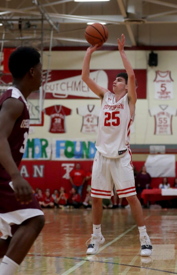 Danny Linehan of Tappan Zee launches a three point shot against Ossining during the Two Counties, One Cause basketball tournament at Tappan Zee High School Jan. 12, 2019.