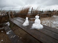 View of snowmen on a picnic table at Herring Point at Cape Henlopen State Park in Lewes.