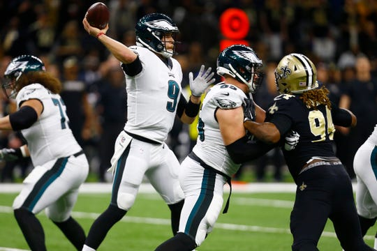 Philadelphia Eagles quarterback Nick Foles (9) works against the New Orleans Saints in the first half of an NFL divisional playoff football game in New Orleans, Sunday, Jan. 13, 2019. (AP Photo/Butch Dill)