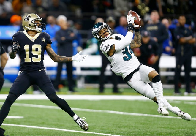 Philadelphia Eagles cornerback Cre'von LeBlanc (34) intercepts the ball against New Orleans Saints quarterback Drew Brees (9) in the first half of an NFL divisional playoff football game in New Orleans, Sunday, Jan. 13, 2019. (AP Photo/Butch Dill)