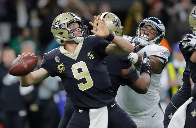 New Orleans Saints quarterback Drew Brees (9) works in the first half of an NFL divisional playoff football game against the Philadelphia Eagles, in New Orleans, Sunday, Jan. 13, 2019. (AP Photo/Gerald Herbert)