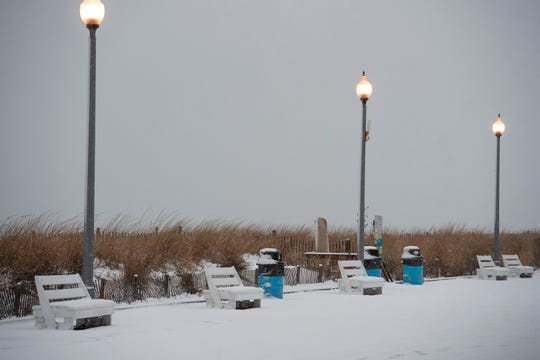 Snow covered boardwalk at Rehoboth Beach.