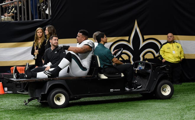 Philadelphia Eagles offensive guard Brandon Brooks (79) leaves the field after an injury against the New Orleans Saints in the first half of an NFL divisional playoff football game in New Orleans, Sunday, Jan. 13, 2019. (AP Photo/Bill Feig)
