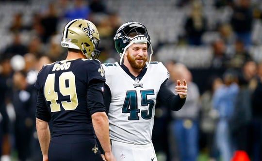 Philadelphia Eagles long snapper Rick Lovato (45) and New Orleans Saints long snapper Zach Wood (49) talk before an NFL divisional playoff football game in New Orleans, Sunday, Jan. 13, 2019. (AP Photo/Butch Dill)