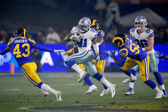 Dallas Cowboys running back Ezekiel Elliott runs against the Los Angeles Rams during the first half in an NFL divisional football playoff game Saturday, Jan. 12, 2019, in Los Angeles.