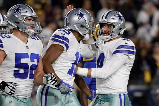 Dallas Cowboys quarterback Dak Prescott, right, greets wide receiver Amari Cooper after his touchdown against the Los Angeles Rams during the first half in an NFL divisional football playoff game Saturday, Jan. 12, 2019, in Los Angeles.