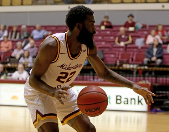 Midwestern State's Gilbert Thomas, Jr. dribbles in the game against Western New Mexico Saturday, Jan. 12, 2019, in D.L. Ligon Coliseum.