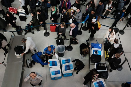 Passengers wait in a Transportation Security Administration line at JFK airport, Jan. 9, 2019, New York City.