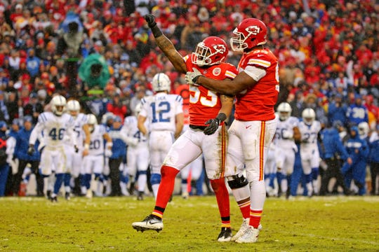 Kansas City Chiefs inside linebacker Anthony Hitchens (53) and defensive end Chris Jones (95) celebrate after a play during the second quarter against the Indianapolis Colts in an AFC Divisional playoff football game at Arrowhead Stadium.