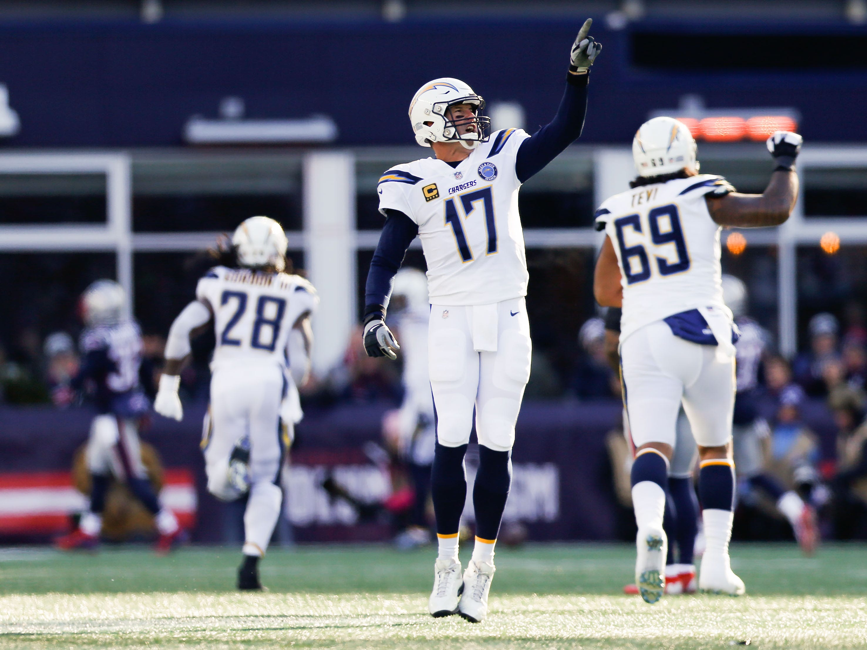 Los Angeles Chargers quarterback Philip Rivers (17) reacts after a touchdown against the New England Patriots during the first quarter in an AFC Divisional playoff football game at Gillette Stadium.