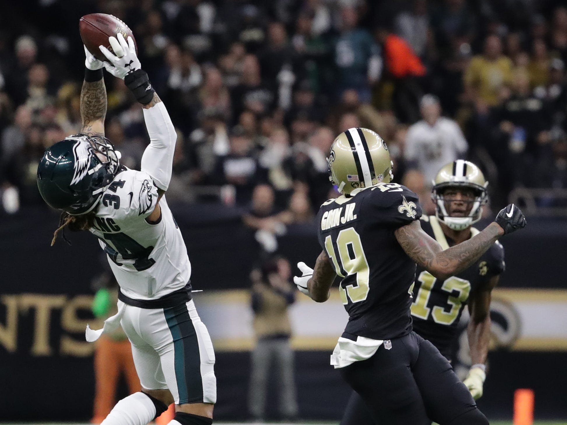 Philadelphia Eagles cornerback Cre'von LeBlanc  intercepts a pass intended for New Orleans Saints wide receiver Ted Ginn.