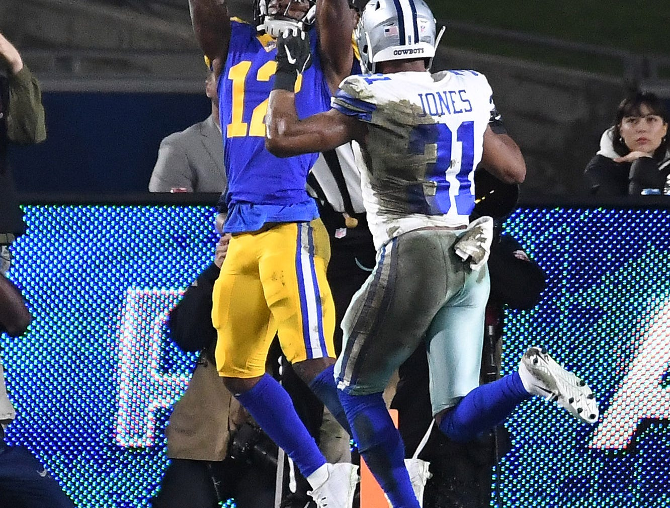 Los Angeles Rams wide receiver Brandin Cooks (12) makes a catch against the Dallas Cowboys in the first half at the Los Angeles Memorial Coliseum.