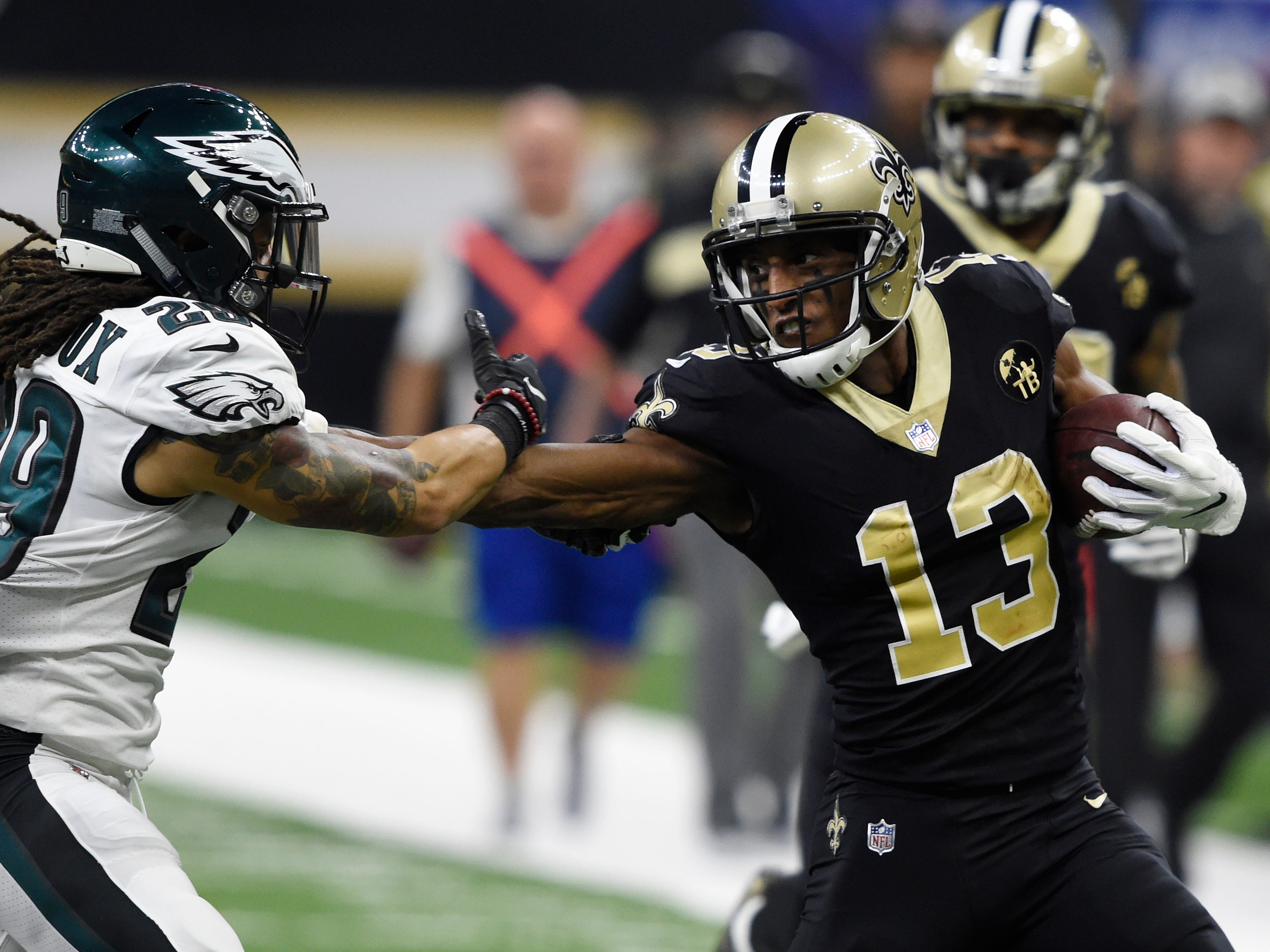 New Orleans Saints wide receiver Michael Thomas stiff arms Philadelphia Eagles free safety Avonte Maddox.