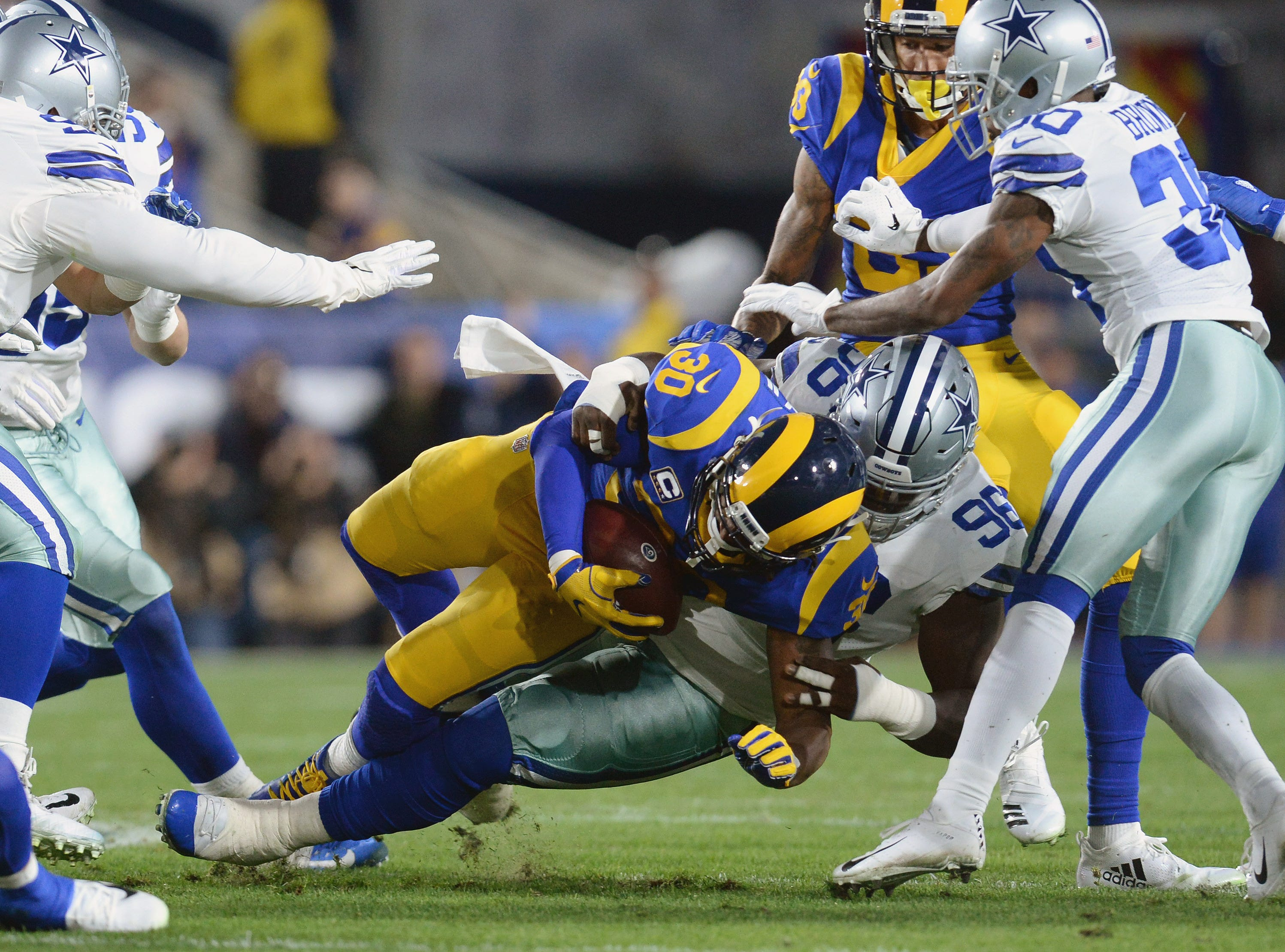 Dallas Cowboys defensive tackle Maliek Collins (96) tackles Los Angeles Rams running back Todd Gurley (30) in the first quarter at the Los Angeles Memorial Coliseum.