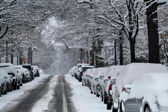 Snow covers parked cars during a winter storm on Jan. 13 in Washington.