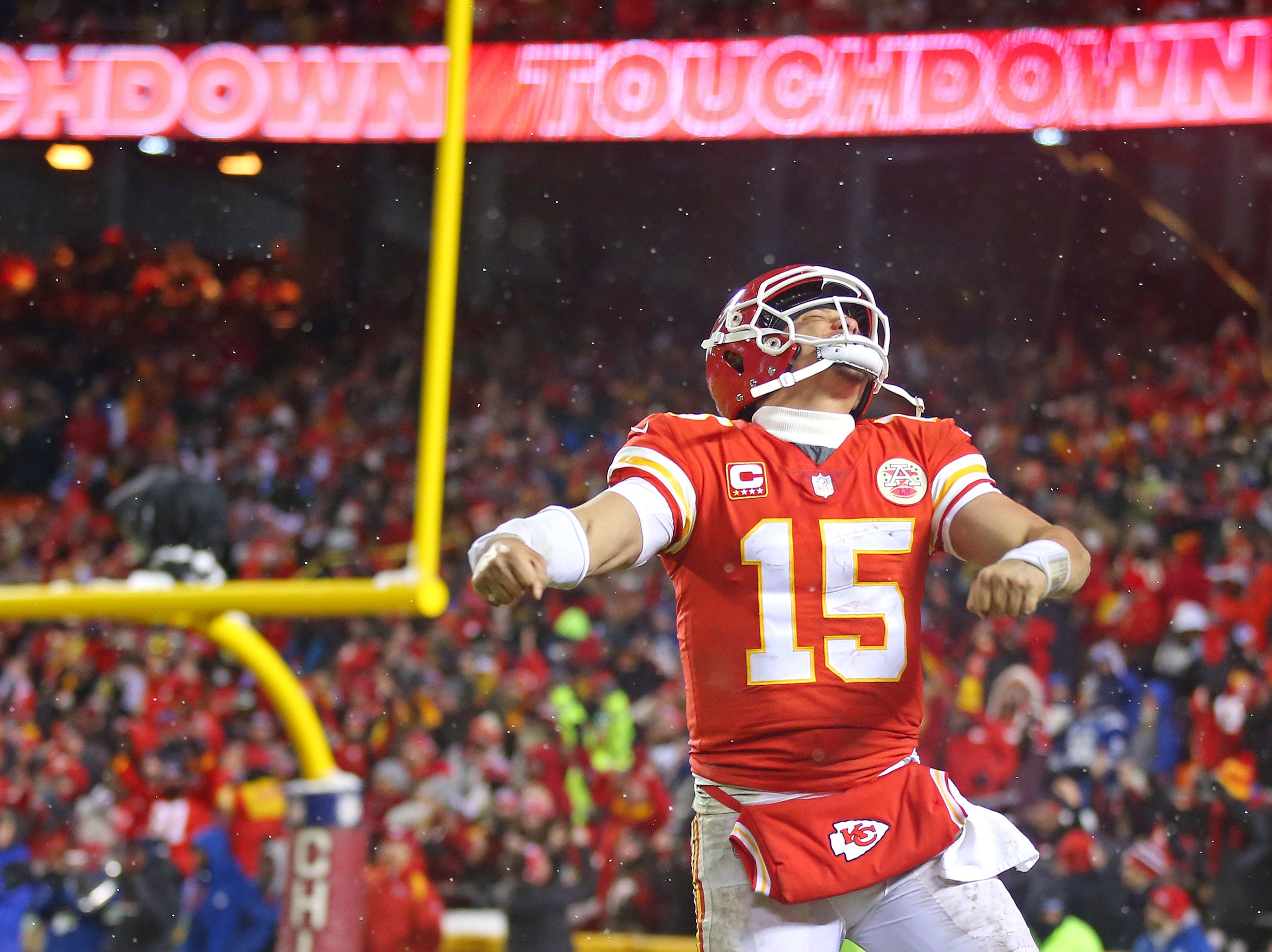 Kansas City Chiefs quarterback Patrick Mahomes (15) celebrates after a touchdown during the fourth quarter against the Indianapolis Colts at Arrowhead Stadium.