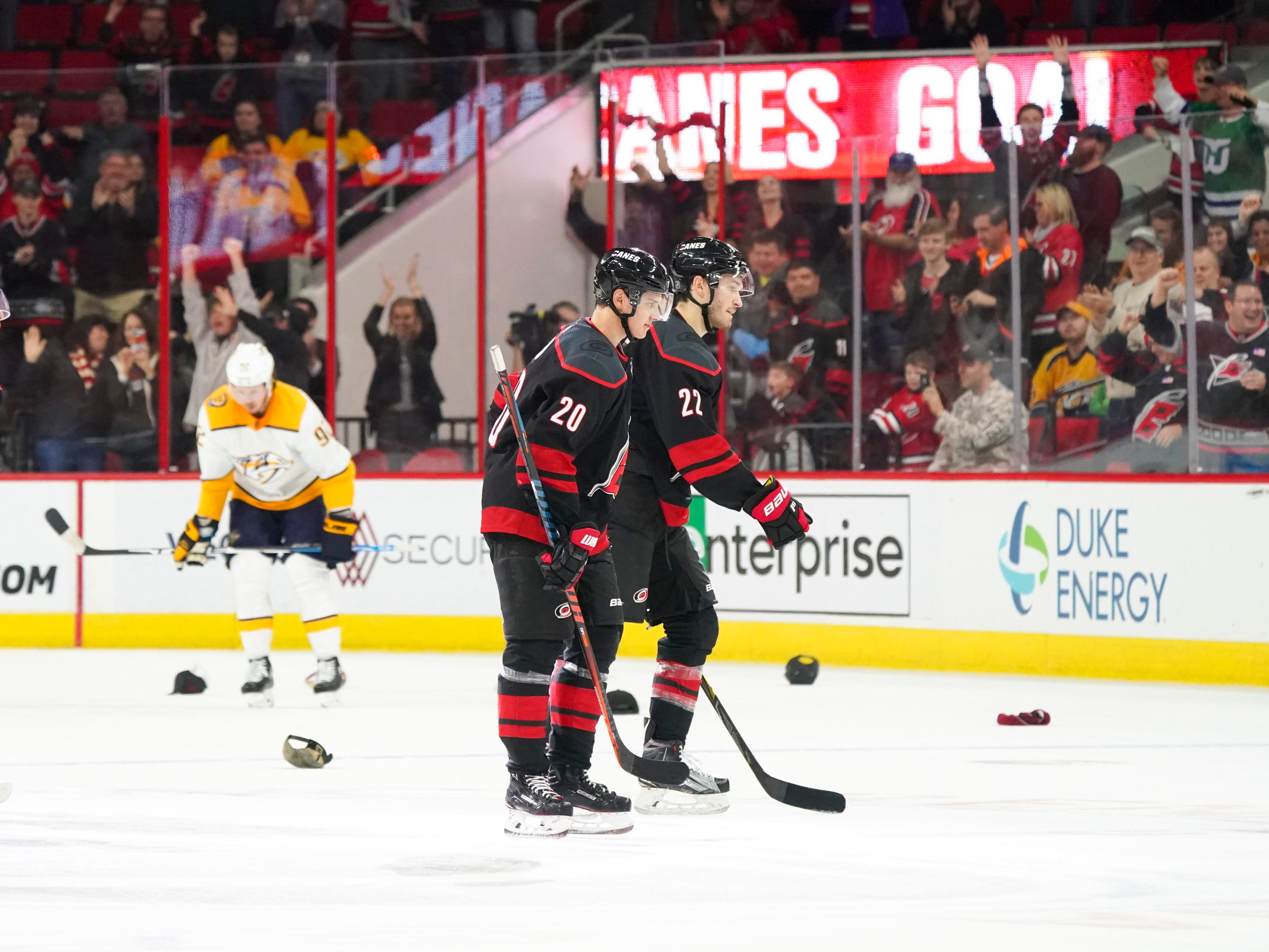Jan. 13: Carolina Hurricanes forward Sebastian Aho (20) skates past hats  after he scores his third goal against the Nashville Predators. He scored at even strength, on the power play and while his team was short-handed.