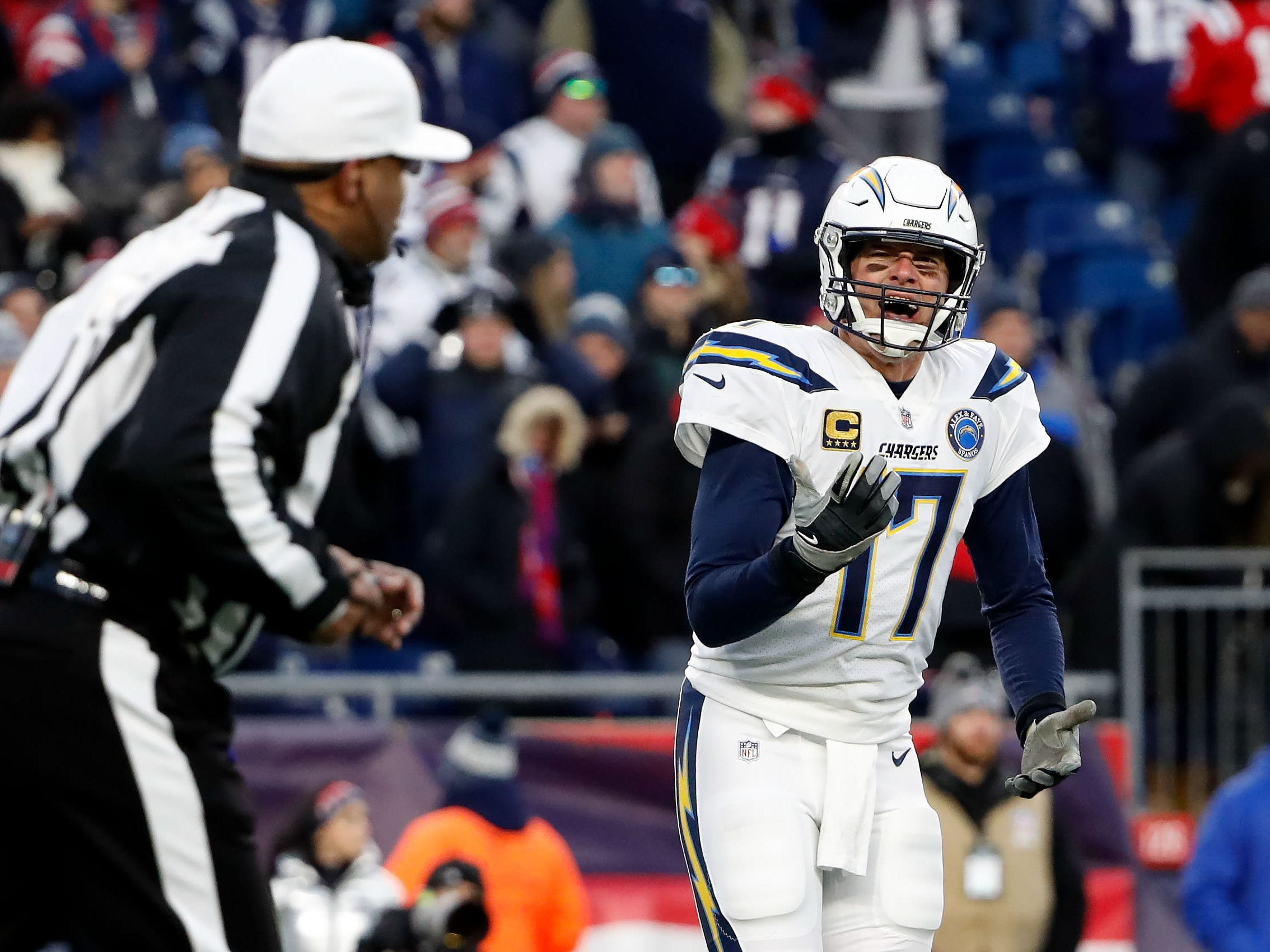 Los Angeles Chargers quarterback Philip Rivers (17) shouts to an official after a sack by the New England Patriots during the fourth quarter in an AFC Divisional playoff football game at Gillette Stadium.