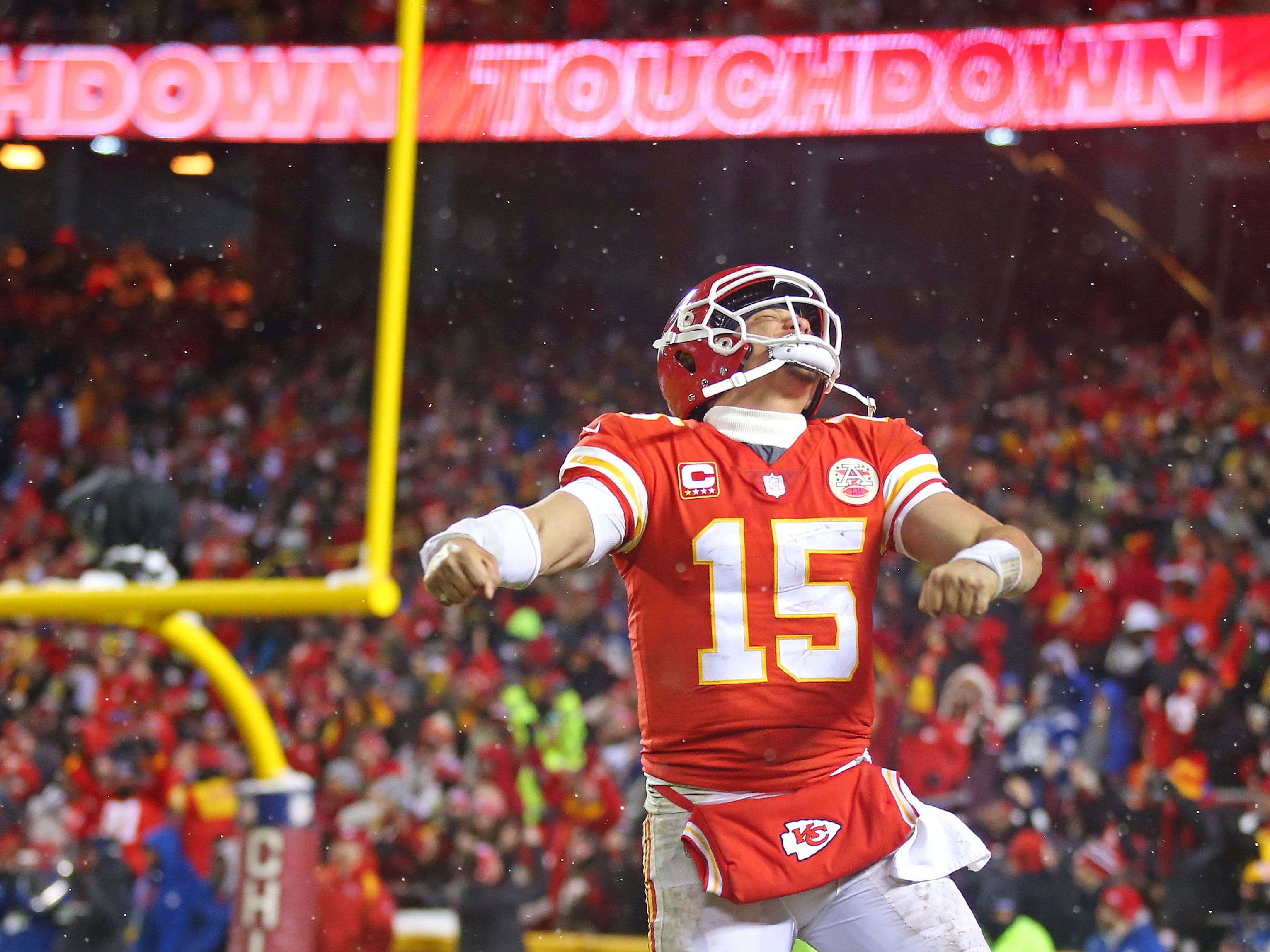 Kansas City Chiefs quarterback Patrick Mahomes celebrates after a touchdown  against the Indianapolis Colts in the AFC divisional playoff game at Arrowhead Stadium.
