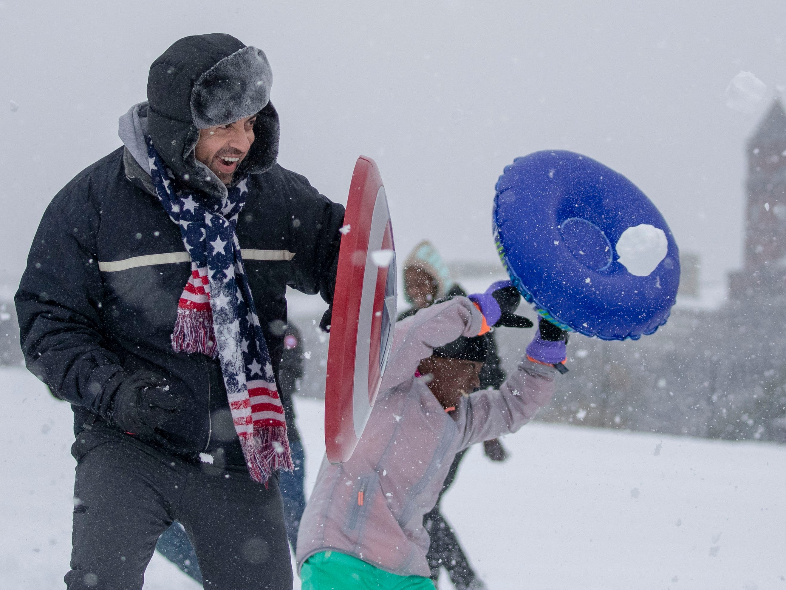 People participate in a snowball fight on the National Mall in Washington on Jan. 13, 2019.