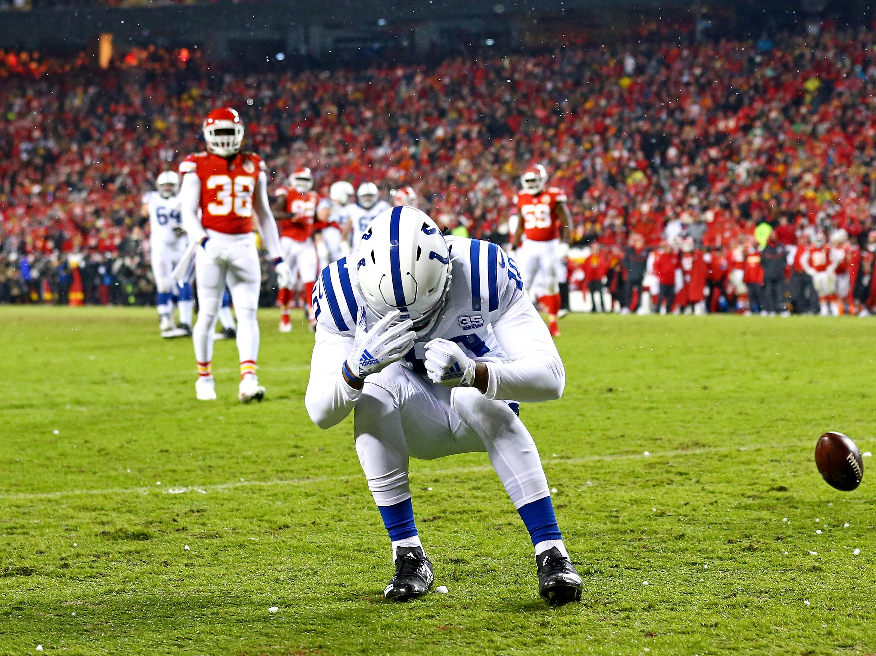 Indianapolis Colts wide receiver Daurice Fountain (10) reacts after missing a catch during the fourth quarter against the Kansas City Chiefs at Arrowhead Stadium.