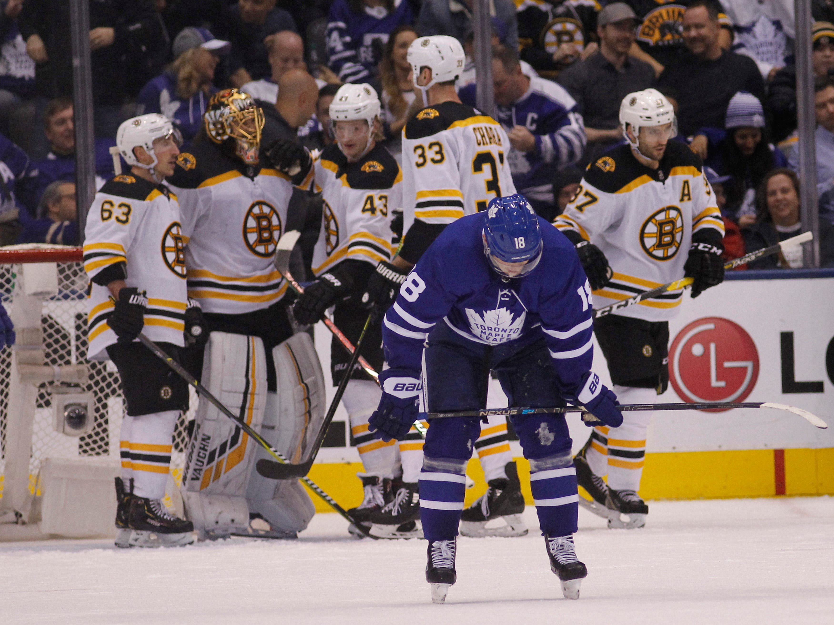 Jan. 12: Toronto Maple Leafs forward Andreas Johnsson (18) skates away as the Boston Bruins celebrate a win over the Toronto Maple Leafs at Scotiabank Arena.