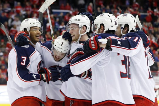 Columbus Blue Jackets left wing Artemi Panarin (9) celebrates with teammates after scoring the game-winning goal in overtime against the Washington Capitals.