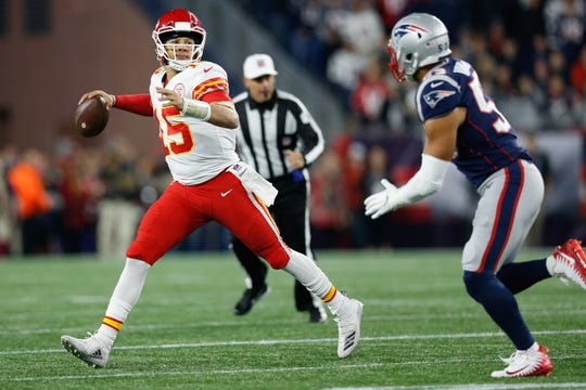 Kansas City Chiefs quarterback Patrick Mahomes (15) prepares to make a pass while defended by New England Patriots linebacker Kyle Van Noy (53) during the second quarter at Gillette Stadium.