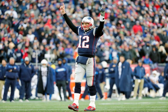 New England Patriots quarterback Tom Brady (12) celebrates after a touchdown against the Los Angeles Chargers during the second quarter in an AFC Divisional playoff football game at Gillette Stadium.
