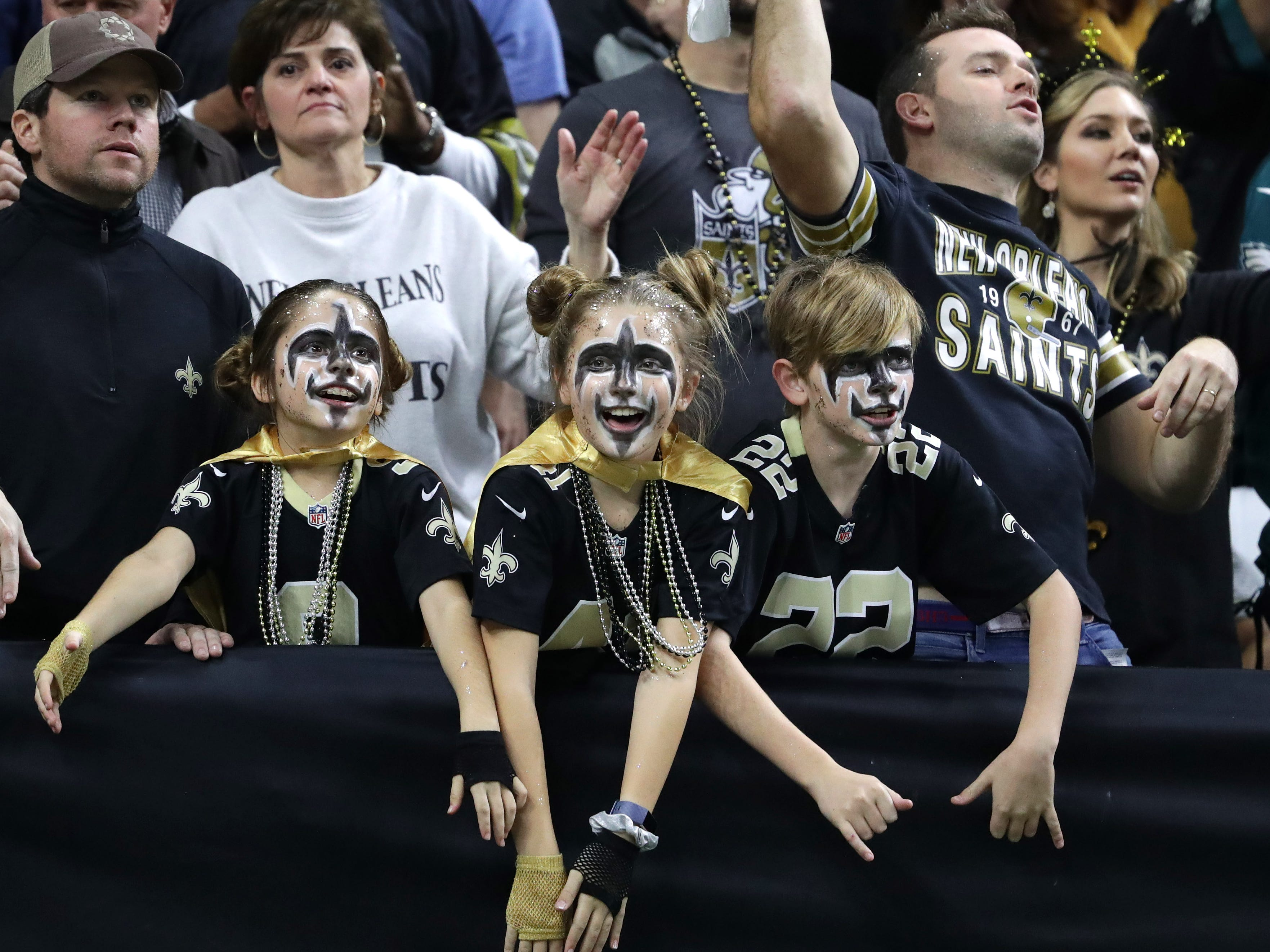New Orleans Saints fans react during the second quarter of the NFC divisional playoff game against the Philadelphia Eagles at Mercedes-Benz Superdome.