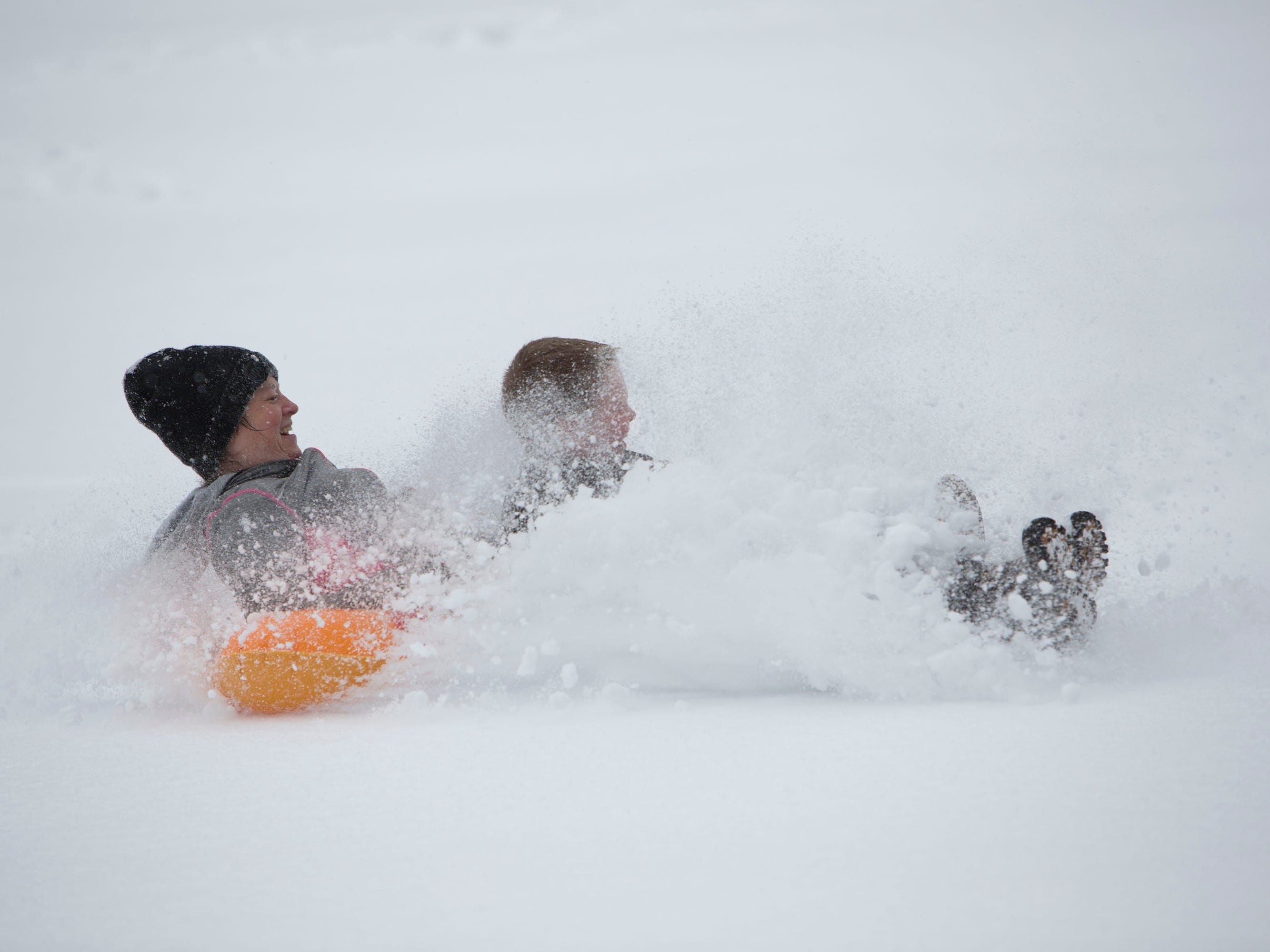 Tammy Adams, left, and her son Evan, 8,  play in the snow at Hidden Creek Country Club on Jan. 13, 2019 in Reston Va.