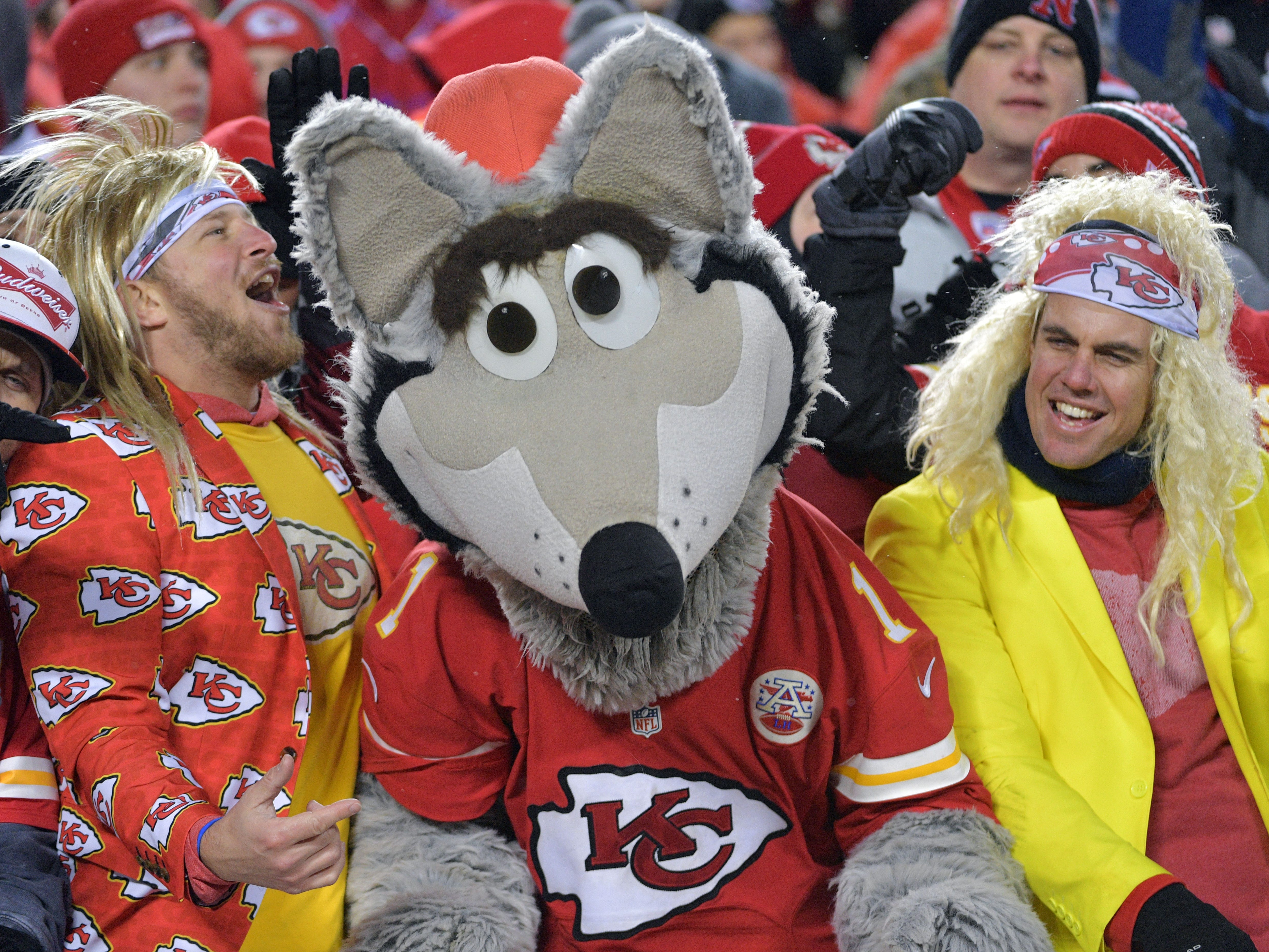 Fans dance with the Kansas City Chiefs mascot during the third quarter of the AFC divisional playoff at Arrowhead Stadium.