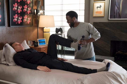 """""""The Upside"""" stars Kevin Hart, right, as an ex-con who becomes a caretaker for a physically disabled author (Bryan Cranston, left)."""