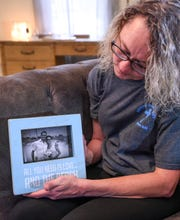 Vickie Harvey Worth talks about her brother Bobby Harvey, seen in a photo with her, in her home near the Anderson city limits Monday. Bobby and his dog, Pup Pup, were killed last March, with his body and his burned truck found near the Anderson-Greenville county line. His killing is unsolved.