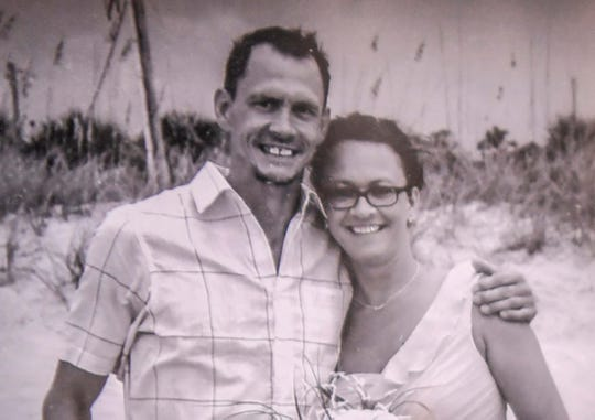 Vickie Harvey Worth, right, in a family photo with her brother Bobby Harvey in her home near the Anderson city limits Monday. Bobby and his dog, Pup Pup, were killed last March, with his body and his burned truck found near the Anderson-Greenville county line. His killing is unsolved.