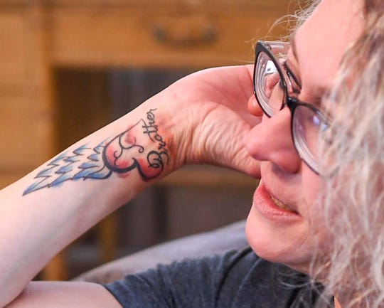 Vickie Harvey Worth talks about her brother Bobby Harvey in her home near the Anderson city limits Monday. Bobby and his dog, Pup Pup, were killed last March, with his body and his burned truck found near the Anderson-Greenville county line. His killing is unsolved.