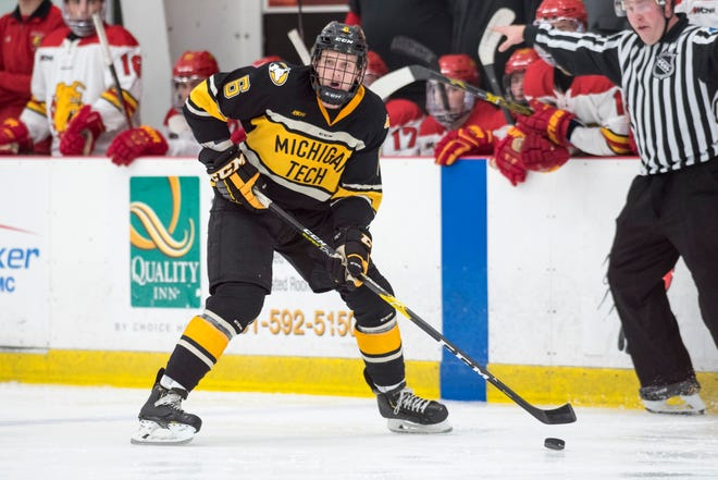 Cooper Watson, a sophomore defender on the Michigan Tech hockey team, controls the puck against Ferris State during a game earlier this season.
