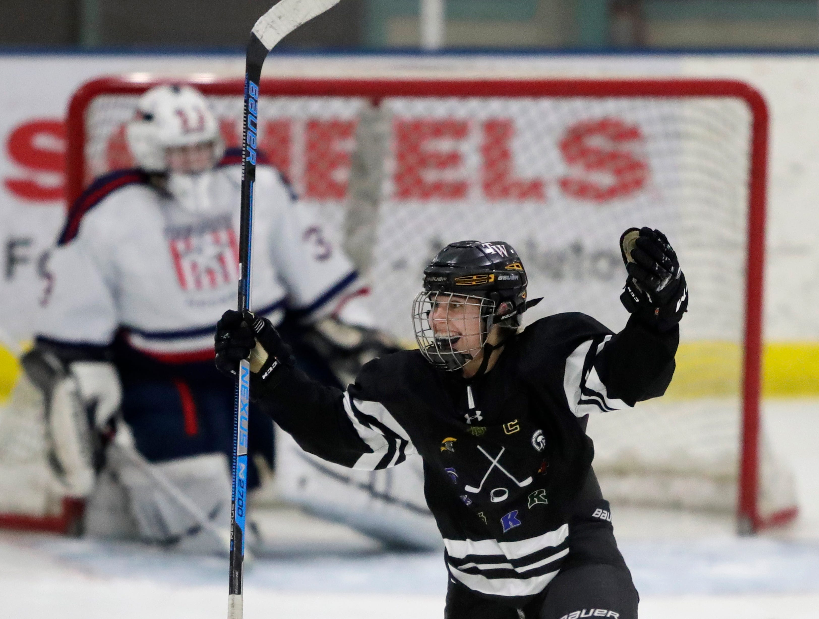 The Warbirds' Alyssa Heim (37) celebrates scoring a goal against Fox Cities Stars' Hattie Berndt (33) during their girls hockey game Thursday, January 10, 2019, at Tri-County Ice Arena in Fox Crossing, Wis. 