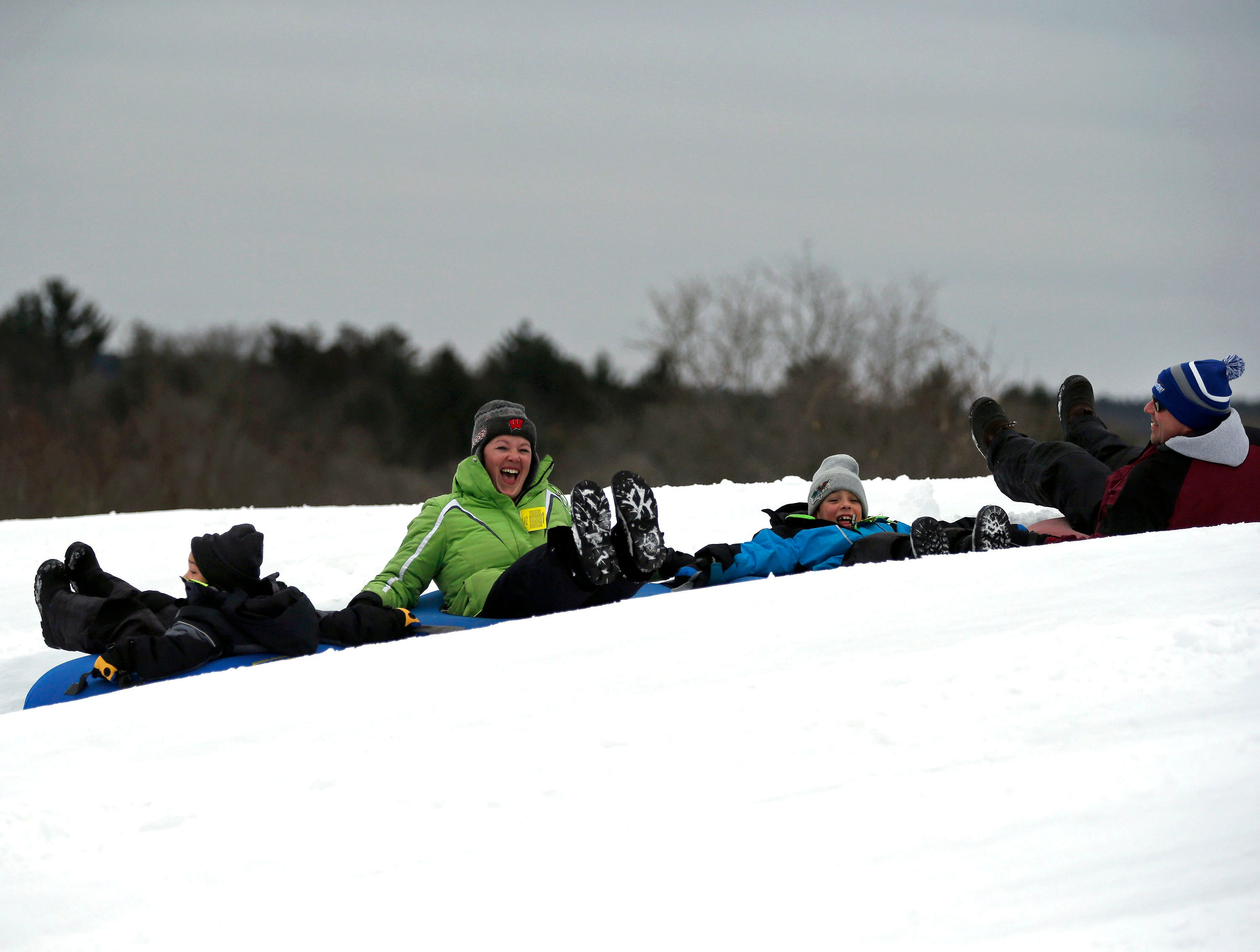 Jamie Kuklinski of Green Bay has a laugh on her ride down the hill as a mild winter day brings tubing fans to Nordic Mountain Sunday, January 13, 2019, near Wild Rose, Wis.